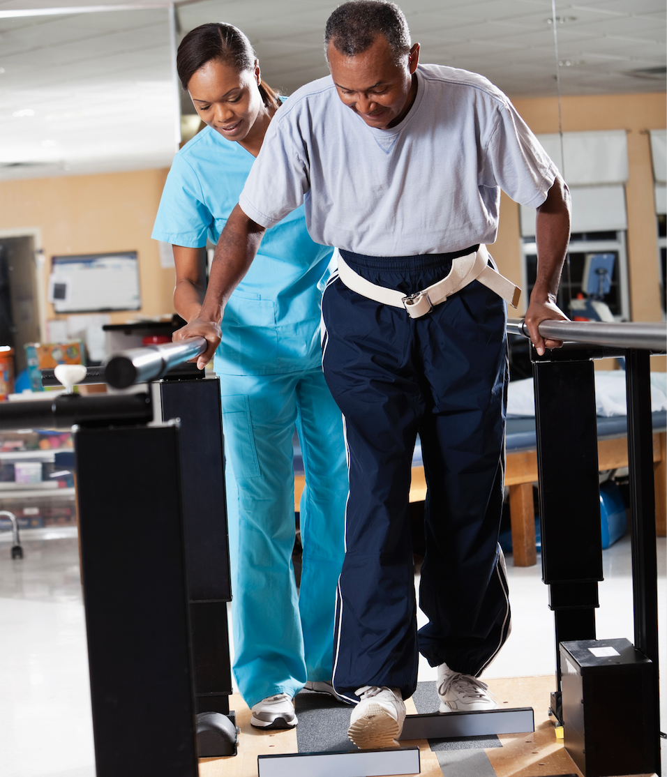 balance therapist assisting patient to regain balance